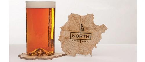 бокал пива с дном в виде горы